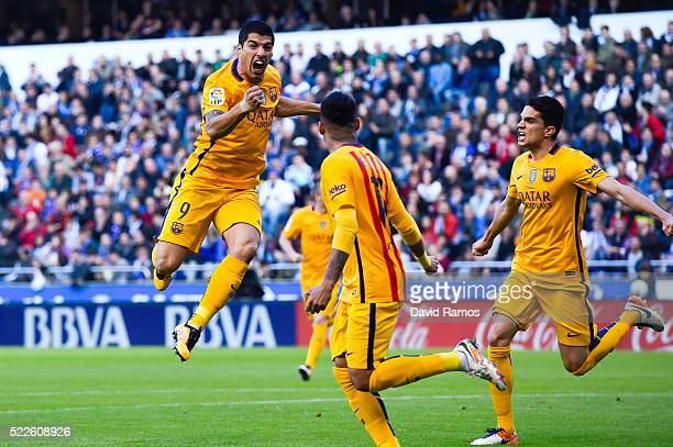 Luis Suarez of FC Barcelona celebrates with his team mates after scoring the opening goalduring the La Liga match between RC Deportivo La Coruna and...