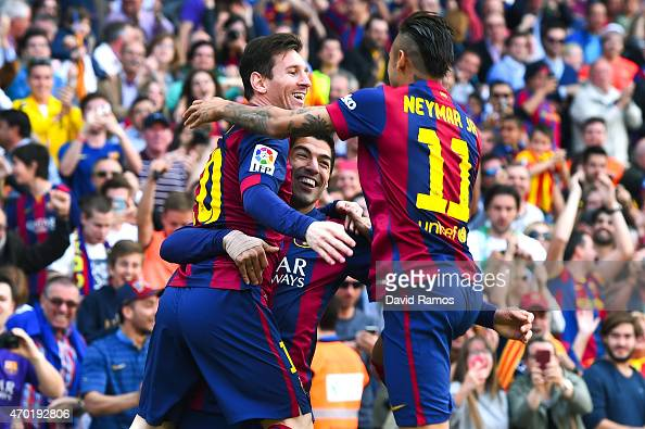 Luis Suarez of FC Barcelona celebrates with his team mates Lionel Messi and Neymar of FC Barcelona after scoring the opening goal during the La Liga...