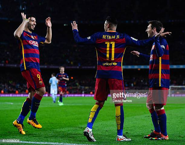 Luis Suarez of FC Barcelona celebrates with his team mates Neymar and Lionel Messi of FC Barcelona after scoring his team's third goal during the La...