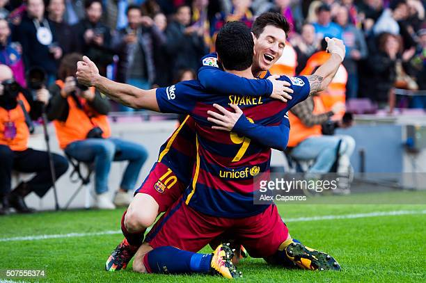 Luis Suarez of FC Barcelona celebrates with his teammate Lionel Messi after scoring his team's second goal during the La Liga match between FC...
