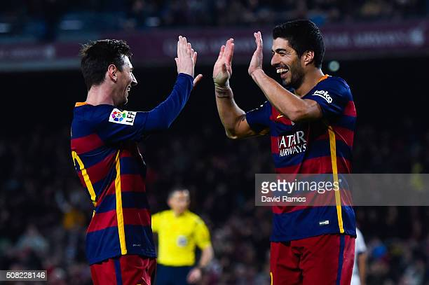 Luis Suarez of FC Barcelona celebrates with his teammate Lionel Messi after scoring his team's seventh goal during the Copa del Rey Semi Final first...