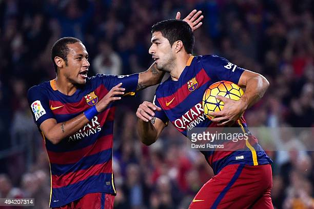 Luis Suarez of FC Barcelona celebrates with his teammate Neymar of FC Barcelona after scoring the opening goal during the La Liga match between FC...