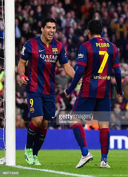 Luis Suarez of FC Barcelona celebrates with his teammate Pedro Rodriguez of FC Barcelona after scoring his team's second goalduring the La Liga match...
