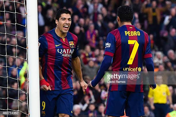 Luis Suarez of FC Barcelona celebrates with his teammate Pedro Rodriguez of FC Barcelona after scoring his team's second goalduring the La Liga match...
