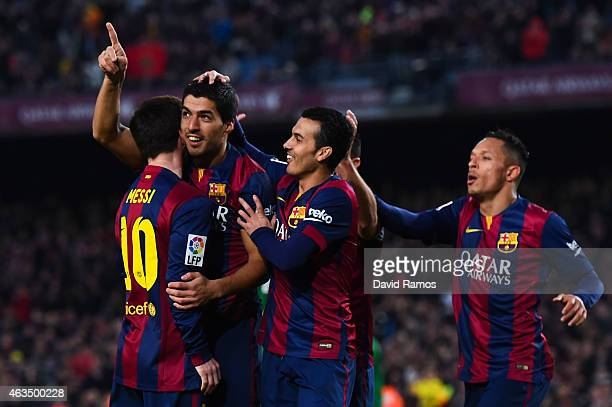 Luis Suarez of FC Barcelona celebrates with his teammates after scoring his team's fifth goal during the La Liga match between FC Barcelona and...