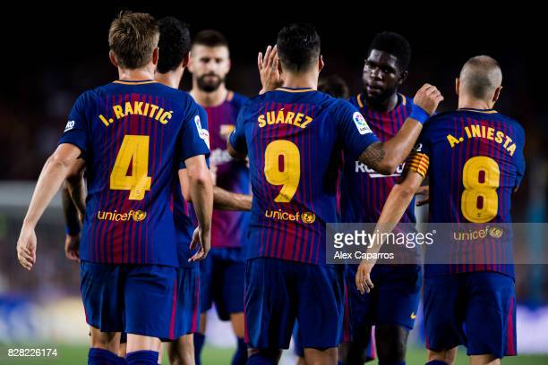 Luis Suarez of FC Barcelona celebrates with his teammates Ivan Rakitic Samuel Umtiti and Andres Iniesta after scoring his team's fourth goal during...