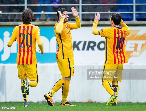 Luis Suarez of FC Barcelona celebrates with his teammates Lionel Messi and Roberto Carnicer of FC Barcelona after scoring his team's fourth goal...
