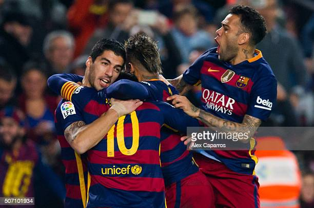 Luis Suarez of FC Barcelona celebrates with his teammates Lionel Messi Neymar Santos Jr and Dani Alves after scoring his team's first goal during the...