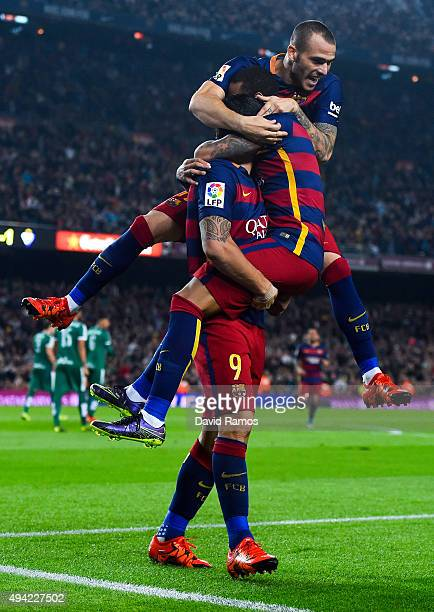 Luis Suarez of FC Barcelona celebrates with his teammates Neymar and Sandro Ramirez of FC Barcelona after scoring his team's second goal during the...