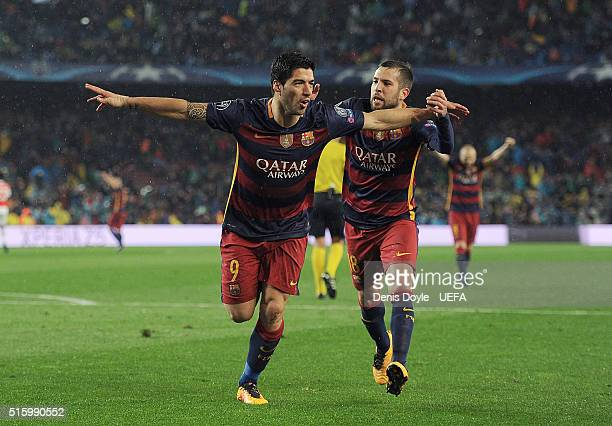 Luis Suarez of FC Barcelona celebrates with Jordi Alba after scoring his team's 2nd goal during the UEFA Champions League Round of 16 second leg...