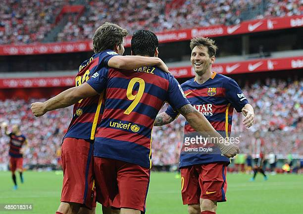 Luis Suarez of FC Barcelona celebrates with Lionel Messi and Sergi Roberto after scoring Barcelona opening goal during the La Liga match between...
