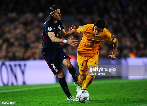 Luis Suarez of FC Barcelona competes for the ball with Filipe Luis of Atletico de Madrid during the UEFA Champions League quarter final first leg...