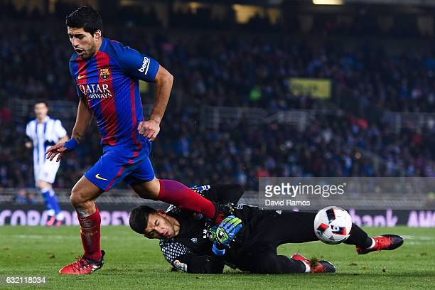 Luis Suarez of FC Barcelona competes for the ball with Geronimo Rulli of Real Sociedad de Futbol during the Copa del Rey quarterfinal first leg match...
