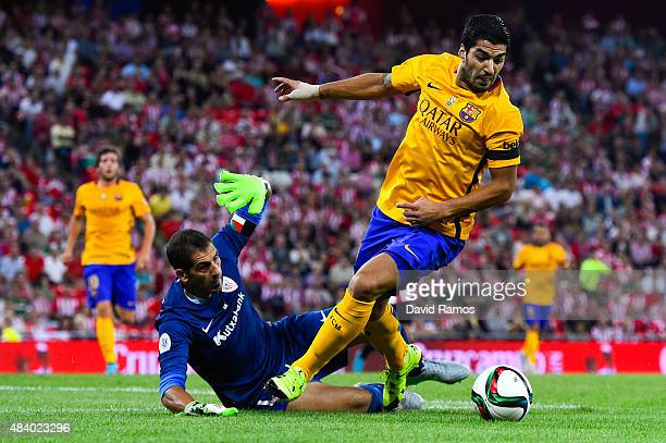 Luis Suarez of FC Barcelona competes for the ball with Gorka Iraizoz of Athletic Club during the Spanish Super Cup first leg match between FC...