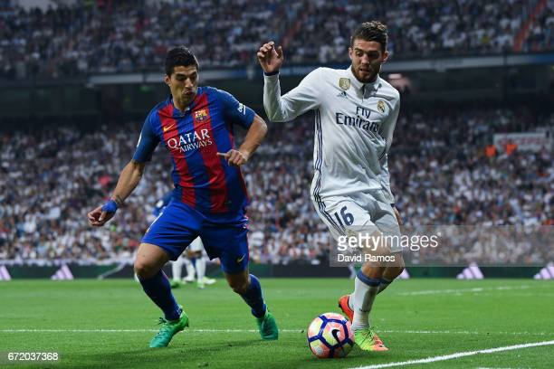 Luis Suarez of FC Barcelona competes for the ball with Mateo Kovacic of Real Madrid CF during the La Liga match between Real Madrid CF and FC...