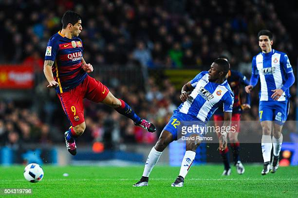 Luis Suarez of FC Barcelona competes for the ball with Pape Diop of RCD Espanyol during the Copa del Rey Round of 16 first leg match between FC...