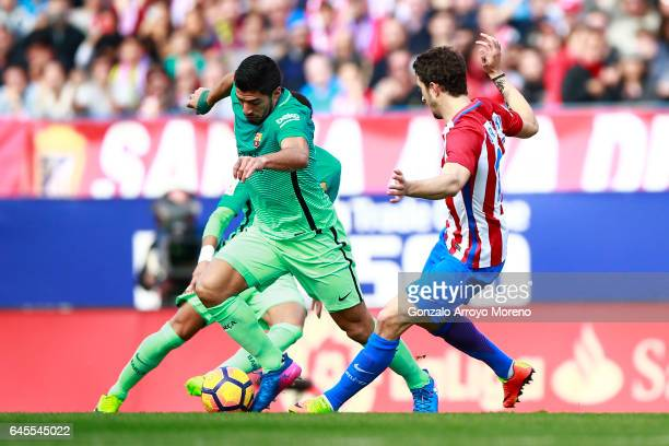 Luis Suarez of FC Barcelona competes for the ball with Sime Vrsaljko of Atletico de Madrid during the La Liga match between Club Atletico de Madrid...