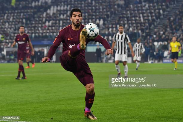 Luis Suarez of FC Barcelona controls the ball during the UEFA Champions League group D match between Juventus and FC Barcelona at Allianz Stadium on...