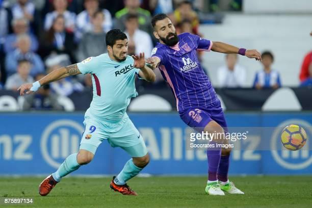 Luis Suarez of FC Barcelona Dimitrios Siovas of Leganes during the Spanish Primera Division match between Leganes v FC Barcelona at the Estadio...