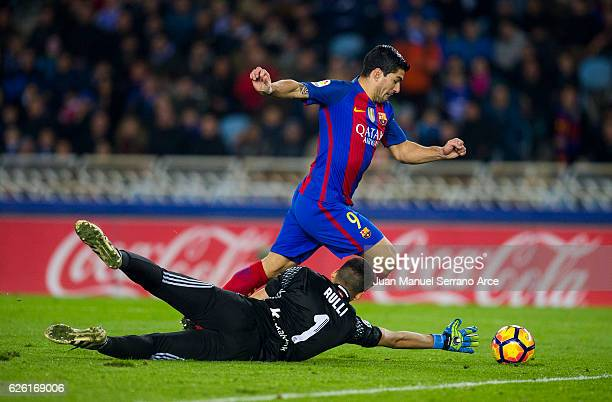 Luis Suarez of FC Barcelona duels for the ball with Geronimo Rulli of Real Sociedad during the La Liga match between Real Sociedad de Futbol and FC...