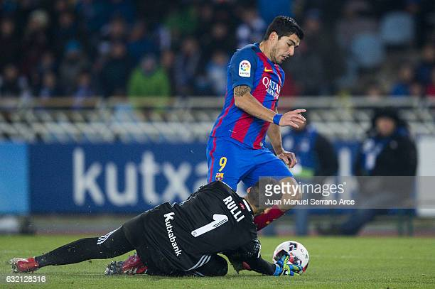 Luis Suarez of FC Barcelona duels for the ball with Geronimo Rulli of Real Sociedad during the Copa del Rey Quarter Final First Leg match between...
