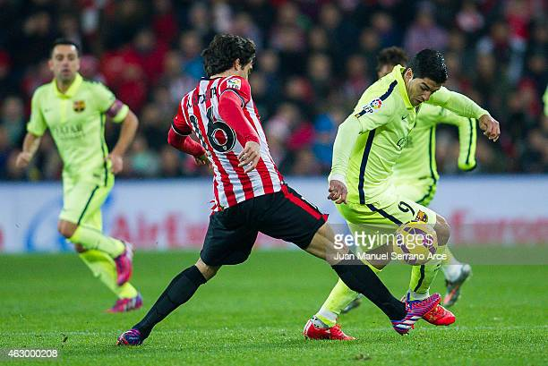 Luis Suarez of FC Barcelona duels for the ball with Xabier Etxeita of Athletic Club during the La Liga match between Athletic Club and FC Barcelona...