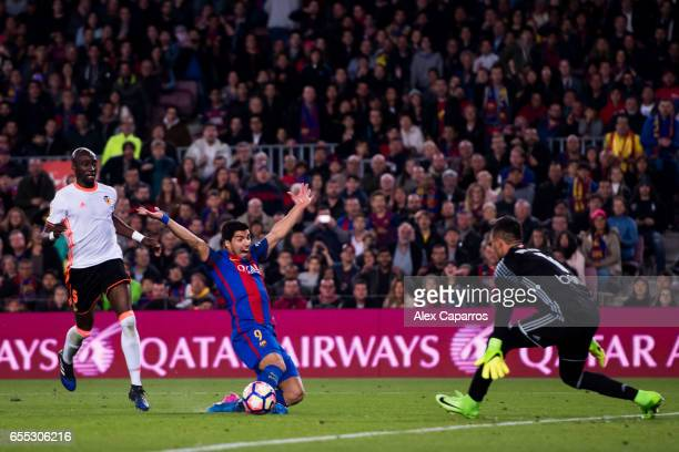 Luis Suarez of FC Barcelona falls after being fouled by Eliaquim Mangala of Valencia CF during the La Liga match between FC Barcelona and Valencia CF...