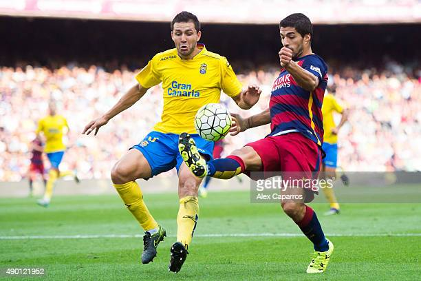 Luis Suarez of FC Barcelona fights for the ball with Antolin Alcaraz of UD Las Palmas during the La Liga match between FC Barcelona and UD Las Palmas...