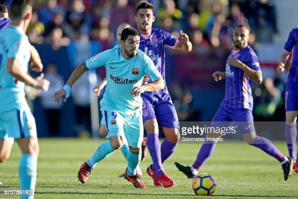 Luis Suarez of FC Barcelona Gabriel of Leganes during the Spanish Primera Division match between Leganes v FC Barcelona at the Estadio Municipal de...