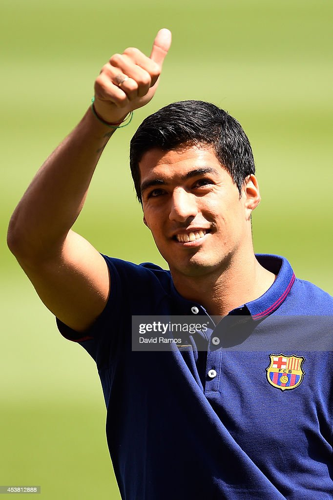 Luis Suarez of FC Barcelona gives his thumbs up during his presentation as new FC Barcelona player at Camp Nou on August 19, 2014 in Barcelona, Spain.