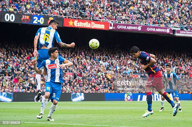 Luis Suarez of FC Barcelona heads the ball towards goal and scores his team's third goal during the La Liga match between FC Barcelona and RCD...