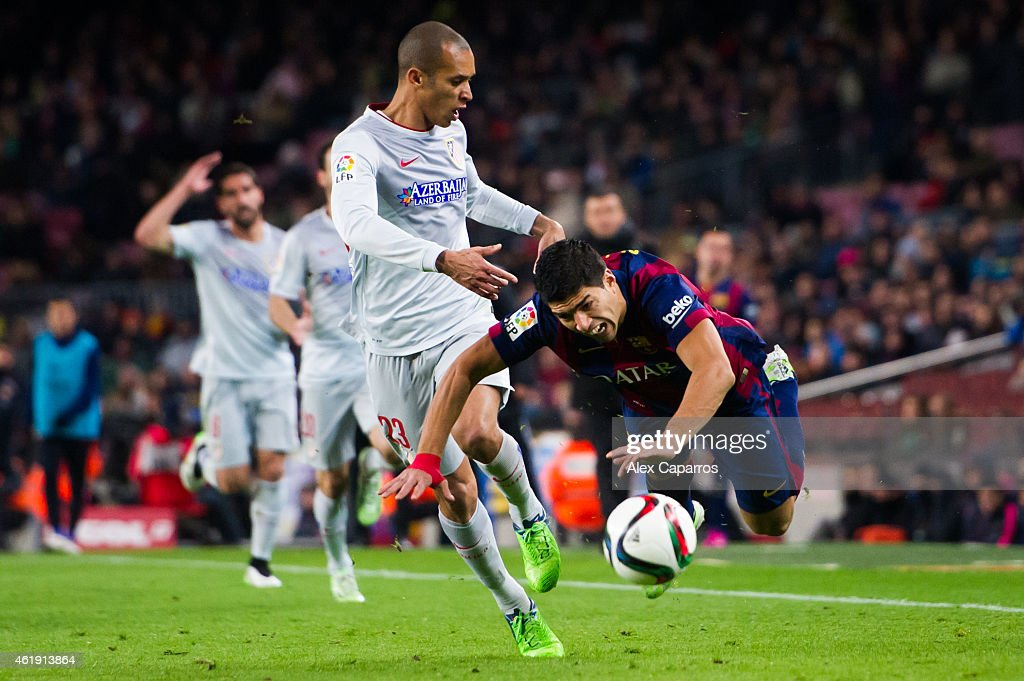 Luis Suarez of FC Barcelona is brought down by Joao Miranda of Club Atletico de Madrid during the Copa del Rey QuarterFinal First Leg match between...