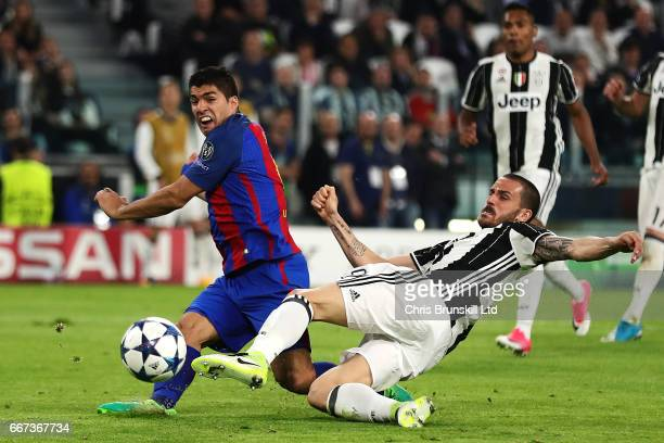Luis Suarez of FC Barcelona is challenged by Leonardo Bonucci of Juventus during the UEFA Champions League Quarter Final first leg match between...
