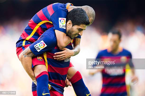 Luis Suarez of FC Barcelona is embraced by his teammate Neymar Santos Jr after scoring his team's second goal during the La Liga match between FC...