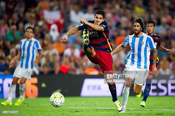 Luis Suarez of FC Barcelona kicks the ball during the La Liga match between FC Barcelona and Malaga CF at Camp Nou on August 29 2015 in Barcelona...