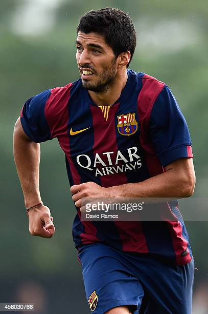 Luis Suarez of FC Barcelona looks on during a friendly match between FC Barcelona B and Indonesia U19 at Ciutat Esportiva on September 24 2014 in...