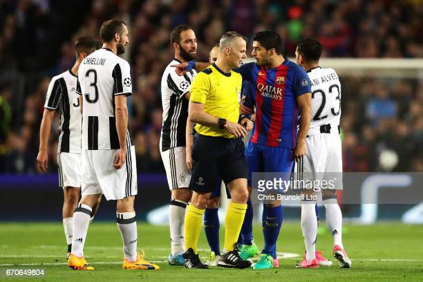 Luis Suarez of FC Barcelona makes a point to referee Bjoern Kuipers during the UEFA Champions League Quarter Final second leg match between FC...