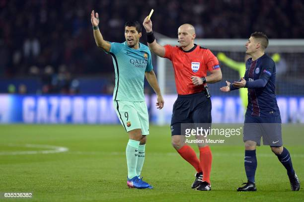 Luis Suarez of FC Barcelona Marco Verratti of Paris SaintGermain react as the referee Szymon Marciniak pulls out a yellow card during the UEFA...
