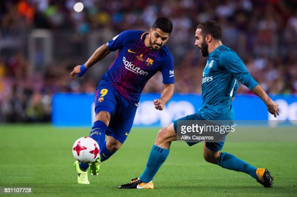Luis Suarez of FC Barcelona plays the ball next to Daniel Carvajal of Real Madrid CF during the Supercopa de Espana Supercopa Final 1st Leg match...