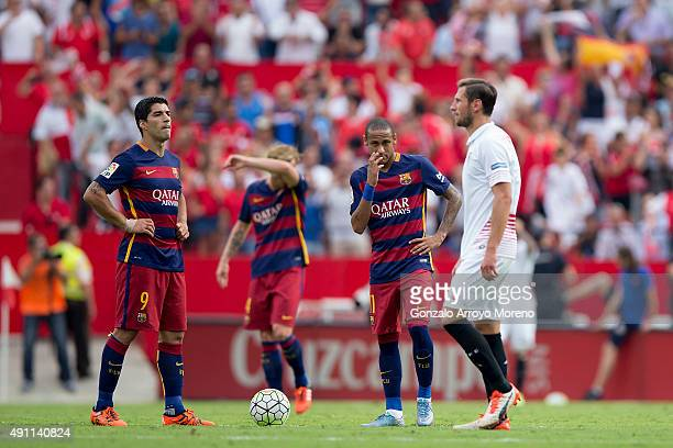 Luis Suarez of FC Barcelona reacts with teammate Neymar JR and Ivan Rakitic as Sevilla FC palyers celebrate their first goal during the La Liga match...