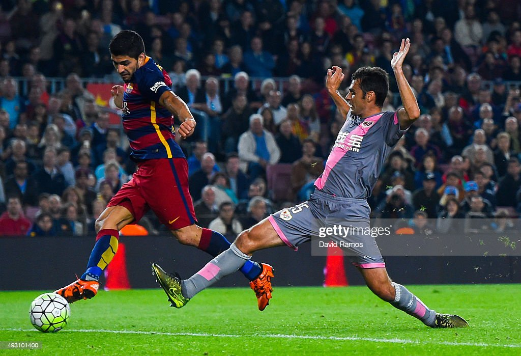 Luis Suarez of FC Barcelona scores his team's fifth goal during the La Liga match between FC Barcelona and Rayo Vallecano at the Camp Nou stadium on October 17, 2015 in Barcelona, Spain.