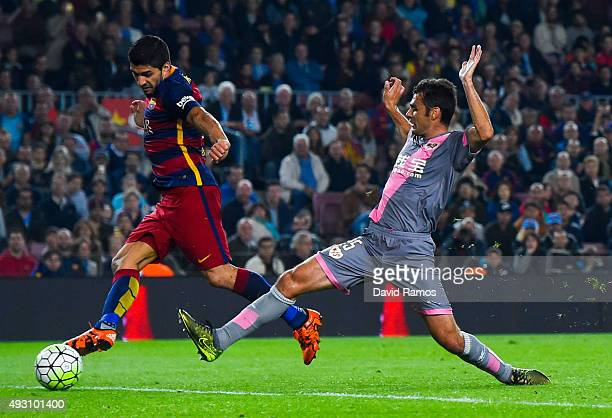 Luis Suarez of FC Barcelona scores his team's fifth goal during the La Liga match between FC Barcelona and Rayo Vallecano at the Camp Nou stadium on...