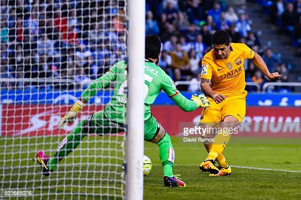 Luis Suarez of FC Barcelona scores his team's fifth goal during the La Liga match between RC Deportivo La Coruna and FC Barcelona at Riazor Stadium...