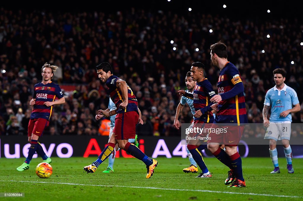 Luis Suarez (C) of FC Barcelona scores his team's fourth goal from the penalty spot after being assisted by <a gi-track='captionPersonalityLinkClicked' href=/galleries/search?phrase=Lionel+Messi&family=editorial&specificpeople=453305 ng-click='$event.stopPropagation()'>Lionel Messi</a> (R) of FC Barcelona during the La Liga match between FC Barcelona and Celta Vigo at Camp Nou on February 14, 2016 in Barcelona, Spain.
