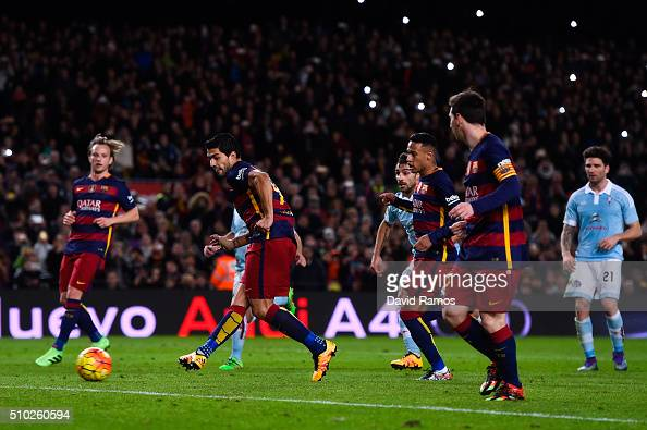 Luis Suarez of FC Barcelona scores his team's fourth goal from the penalty spot after being assisted by Lionel Messi of FC Barcelona during the La...