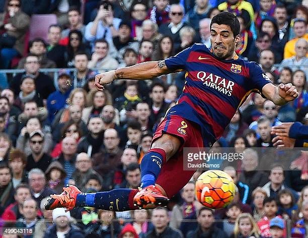 Luis Suarez of FC Barcelona scores his team's second goal during the La Liga match between FC Barcelona and Real Sociedad de Futbol at Camp Nou on...