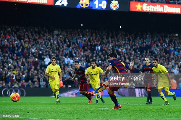 Luis Suarez of FC Barcelona scores his team's second goal from the penalty spot during the La Liga match between FC Barcelona and Villarreal CF at...