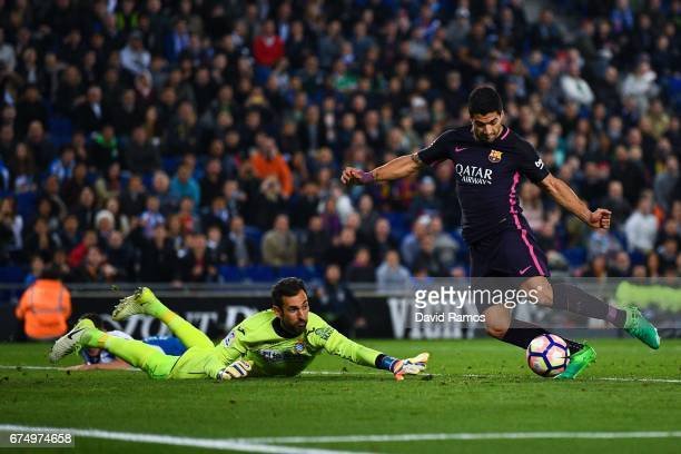 Luis Suarez of FC Barcelona scores his team's third goal past Diego Lopez of RCD Espanyol during the La Liga match between RCD Espanyol and FC...