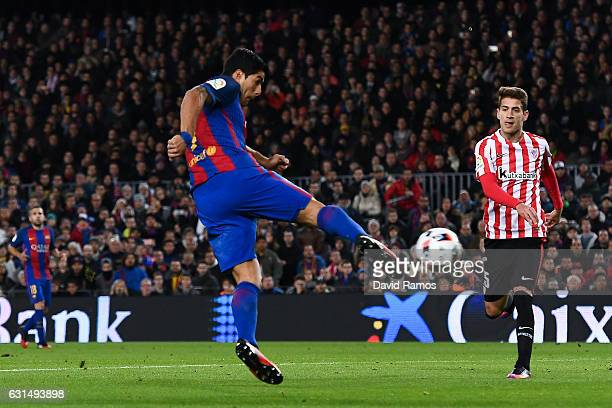 Luis Suarez of FC Barcelona scores the opening goal during the Copa del Rey round of 16 second leg match between FC Barcelona and Athletic Club at...