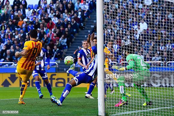 Luis Suarez of FC Barcelona scores the opening goal during the La Liga match between RC Deportivo La Coruna and FC Barcelona at Riazor Stadium on...